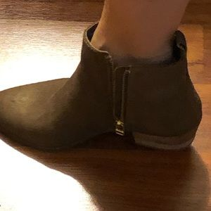 Ankle booties color has a slight gold shimmer